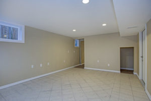 well lit basement with egress window